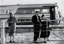 Cornell (left) and Aherne and wife scan Kansas cornfields during 1959 two-man tour of Cornell's Dear Liar. They played in 56 cities traversing 18,000 mis. of American hinterland.