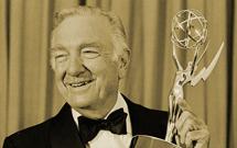 Walter Cronkite holding an Emmy