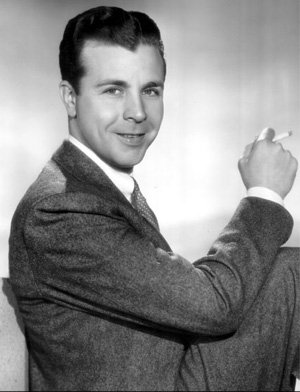 Dick Powell as Richard Diamond