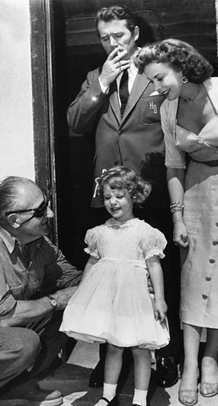 Howard Duff and Ida Lupino introduce their daughter Bridget to lengendary Director Fritz Lang