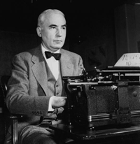 Former CBS News Director Elmer Davis sits at his typewriter as Director of the Office of War Information circa 1942