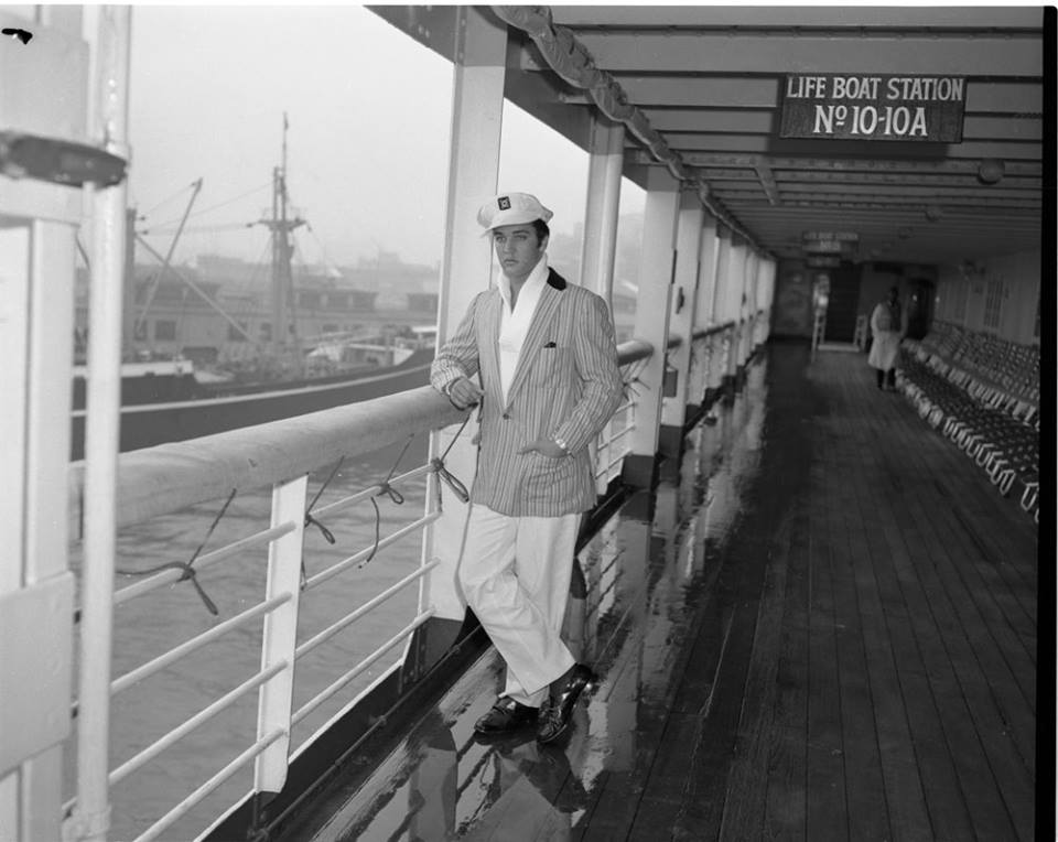 Elvis Presley, all alone, no greeters, on the deck of the Lurline (ship) arriving from Honolulu, November 18, 1957.