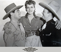 Frances Robinson poses with Johnny Mack Brown and Bob Baker in publicity still for 1940's Riders of Pasco Basin.