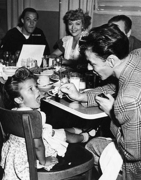 Frank Sinatra feeding daughter Nancy