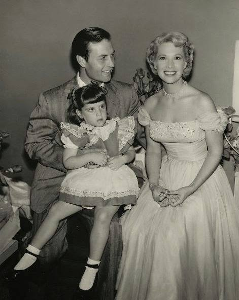 George Montgomery shares some time on set with wife, Dinah Shore and their daughter, Melissa.