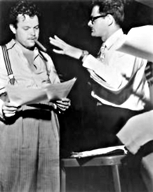 Orson Welles, left and Norman Corwin, right, going over Fourteen August script, August 14, 1945