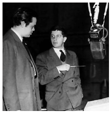 Welles and Herrmann confer on Mercury Theatre score, ca. 1938