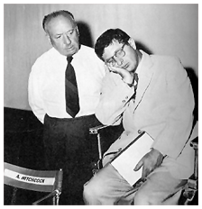 Alfred Hitchcock mugging with Herrmann, ca. 1955