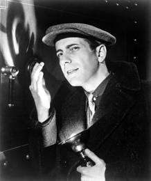 Publicity photo of Bogart cracking a safe, ca. 1932