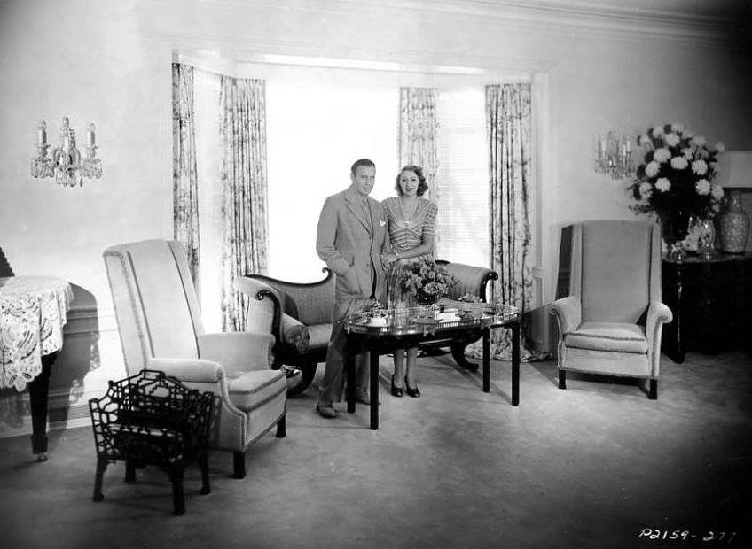 Jack Benny and His wife Mary Livingstone at home in their living room. 1939.