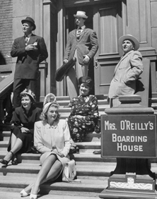 The My Friend Irma crew on the steps of Mrs. O'Rielly's Boarding House, 1947: John Brown at upper right, Marie Wilson at the bottom of the steps