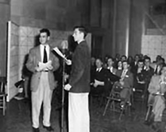 Charles Kuralt - left - and Carl Kasell -at the mike - perform for a WUNC audience at the WUNC studios on the grounds of UNC's Chapel Hill campus circa 1954.