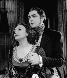 Closeup of Cornell and Aherne on stage in The Barretts of Wimpole Street (1947)