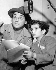 Arch Oboler goes over The Hollywood March Of Dimes Of The Air script with emcee Tommy Cook at the NBC mike (1942)
