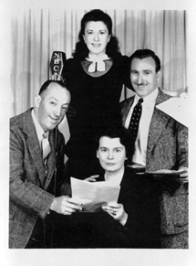Clockwise from left, Charlie Cantor, Minerva Pious, John Brown, and Eileen Douglas at the NBC mike for the Fred Allen Show.