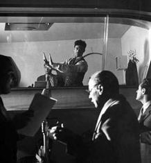 Norman Corwin, directing live radio program, ca. 1944