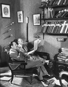 J.D. Carr and Adrian Conan Doyle collaborate over one of Adrian Doyle's Carr-assisted Sherlock Holmes exploits, ca. 1952