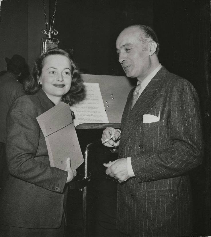 Olivia de Havilland and Charles Boyer