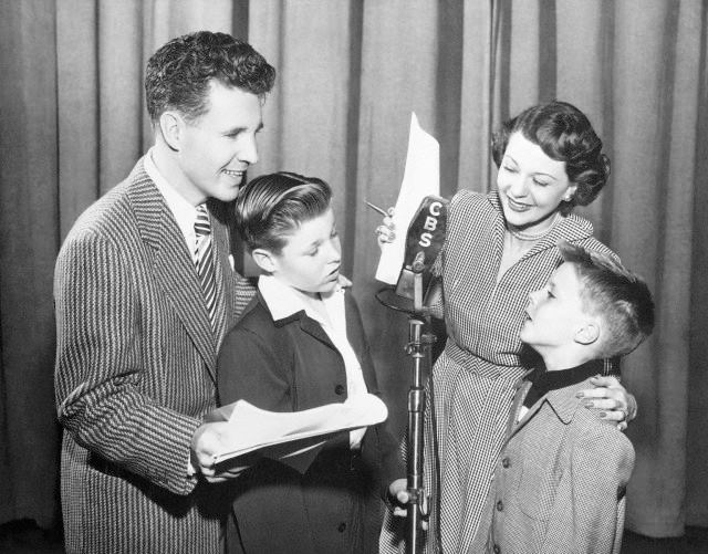 Ozzie and Harriet Nelson with their sons David and Ricky on CBS Radio in 1950.