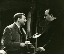 Lorre discusses a scene between takes with Alfred Hitchcock, ca. 1934