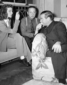 Lorre chats with Katharine Hepburn, ca. 1938