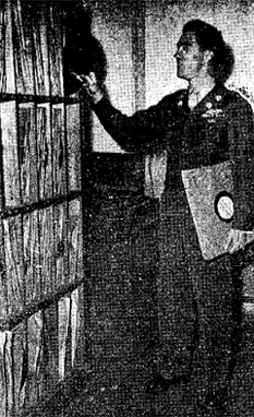 WKLH, KOKURA: Pfc. Terry O'Neill files some records in the basic music library of the Kyushu station.