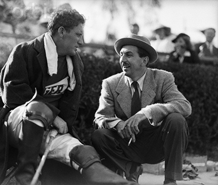 Spencer Tracy and Walt Disney visit between chukkers at a Motion Picture Relief Fund Polo Match fund raiser, ca. 1945.