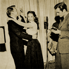 During a rehearsal for Call of Music, Dinah dances with Van Johnson while hubby George Montgomery ignores them.