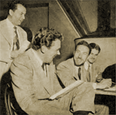 Director Milton Stark, Howard Duff, William Spier and script editor Ed Nathan go over the script--obviously enjoying the process.