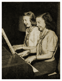 Lurene Tuttle plays a duet at the piano with daughter Barbara
