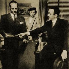 Inspector Farraday (Maurice Tarplin), Mary Wesley (Jan Miner) and Boston Blackie (Richard Kollmar) go over evidence in Farraday's office.
