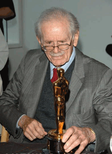 Corwin examines his first, well-deserved Oscar, ca. 2005