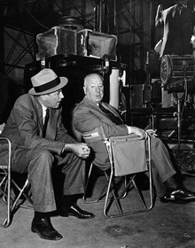 James Stewart confers with Alfred Hitchcock on the set of Rear Window circa 1954