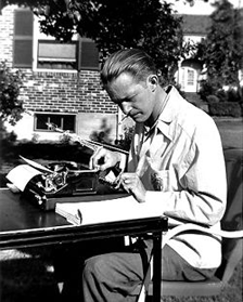 Robert Arthur, Jr. at 'work' at his typewriter, c. 1940