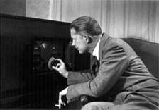 Robert Arthur, Jr. at 'play' at his radio, c. 1942