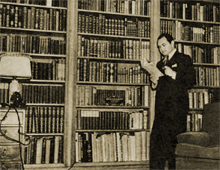 Eddie Robinson peruses one of the hundreds of books in his library.