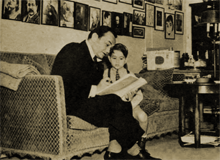 Robinson reads to his son, Manny (Eddie Jr.)