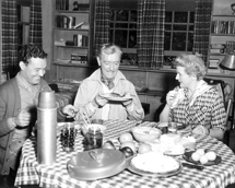 The Colmans -- Ronald and Benita Hume -- roughing it with Jimmy Weldon circa 1957