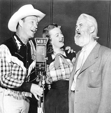 Roy Rogers,Dale Evans,and Gabby Hayes doing a radio show.