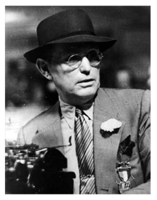 Damon Runyon, sportswriter, ca. 1940, his suit sporting his AEF campaign medal from The Spanish-American War