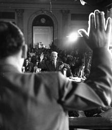 David vs. Goliath. Mental midget McCarthy swears in Mental Giant Hammett during HUAC hearing, ca. 1953