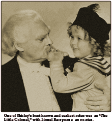 Caption reads -- One of Shirley's best-known and earliest roles was as 'The Little Colonel,' with Lionel Barrymore as co-star.