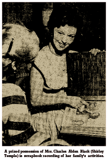Caption reads -- 'A prized possession of Mrs. Charles Eldon Black (Shirley Temple) is scrapbook recording of her family's activities.'