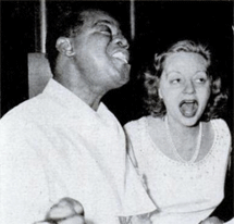 A life-long Jazz fan Tallulah here knocks off an impromptu rendition of ''Melancholy Baby'' with Louis Armstrong.