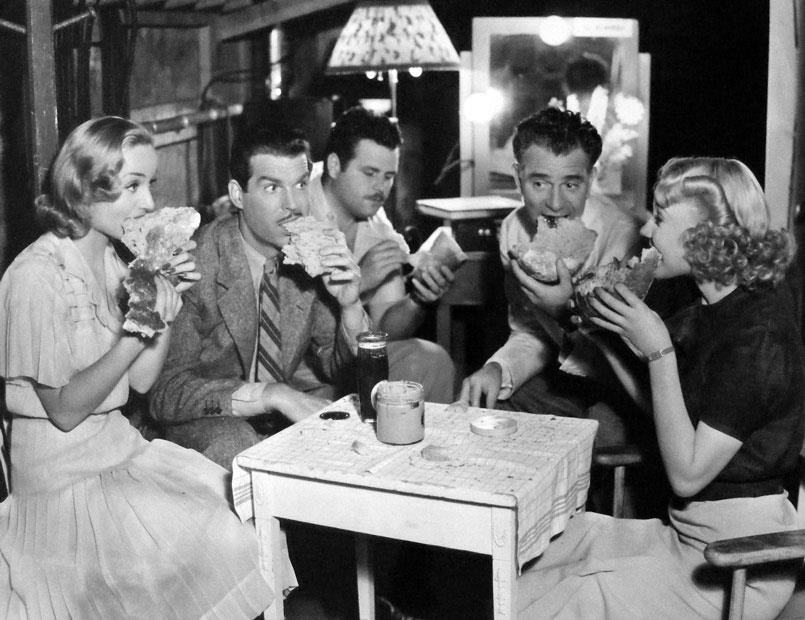 Carole Lombard, Fred MacMurray, writer Claude Binyon, director Wesley Ruggles and Una Merkel, on the set of True Confession.