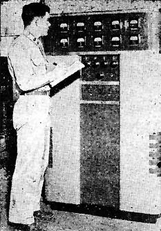 WXLH, OKINAWA: Pfc. Doyle Goodman, technician, checks meter readings on the 250 KRCA transmitter
